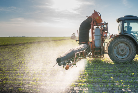 30431095 - tractor spraying soy
