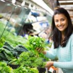 31375074 - young woman choosing leafy vegetables