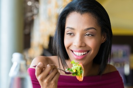 45334789 - woman eating fresh salad