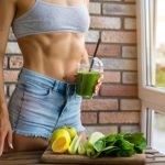 Fit woman drinking Green smoothie.